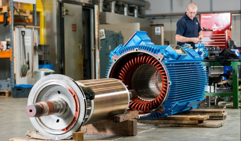 A Westin Drives engineer repairs a large electric motor whose windings have failed.
